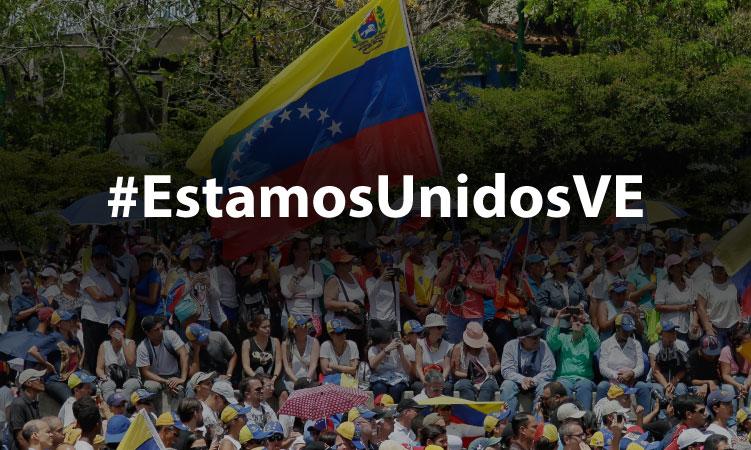 crowd of people rallying in Venezuela