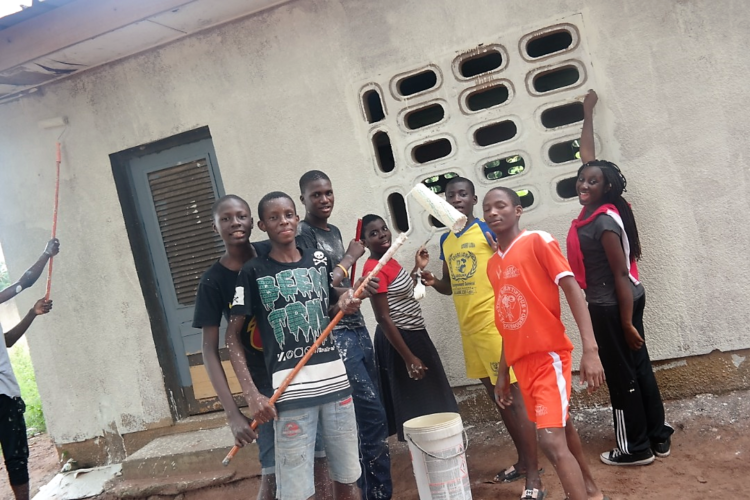 Students painting a public school