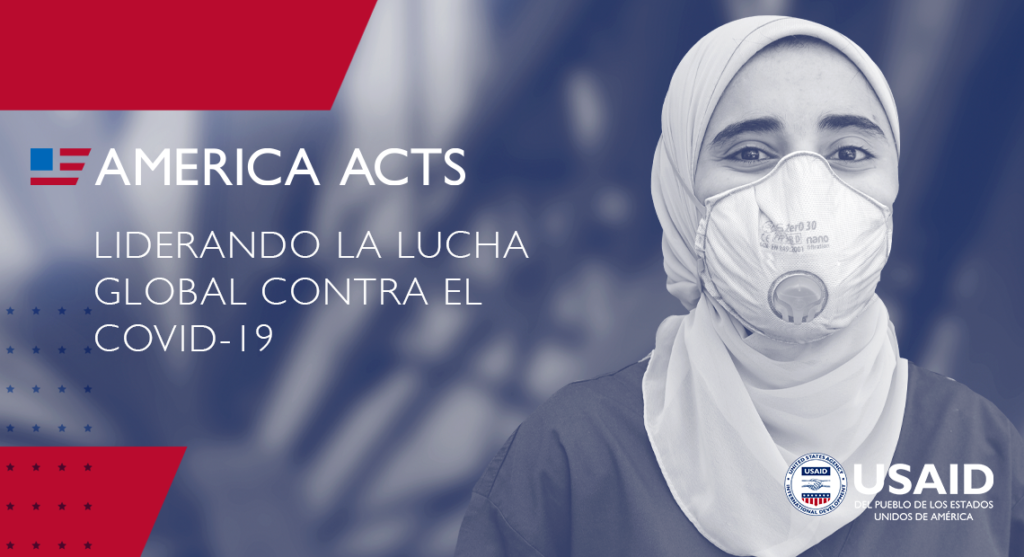 """""""America Acts: Liderando la lucha global contra el COVID-19"""". A woman wears a mask and looks at the camera."""