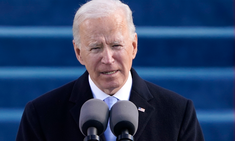 President Biden speaking into a microphone