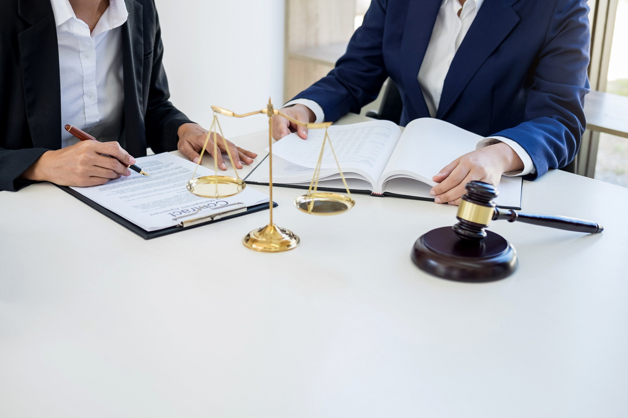 two people with documents
