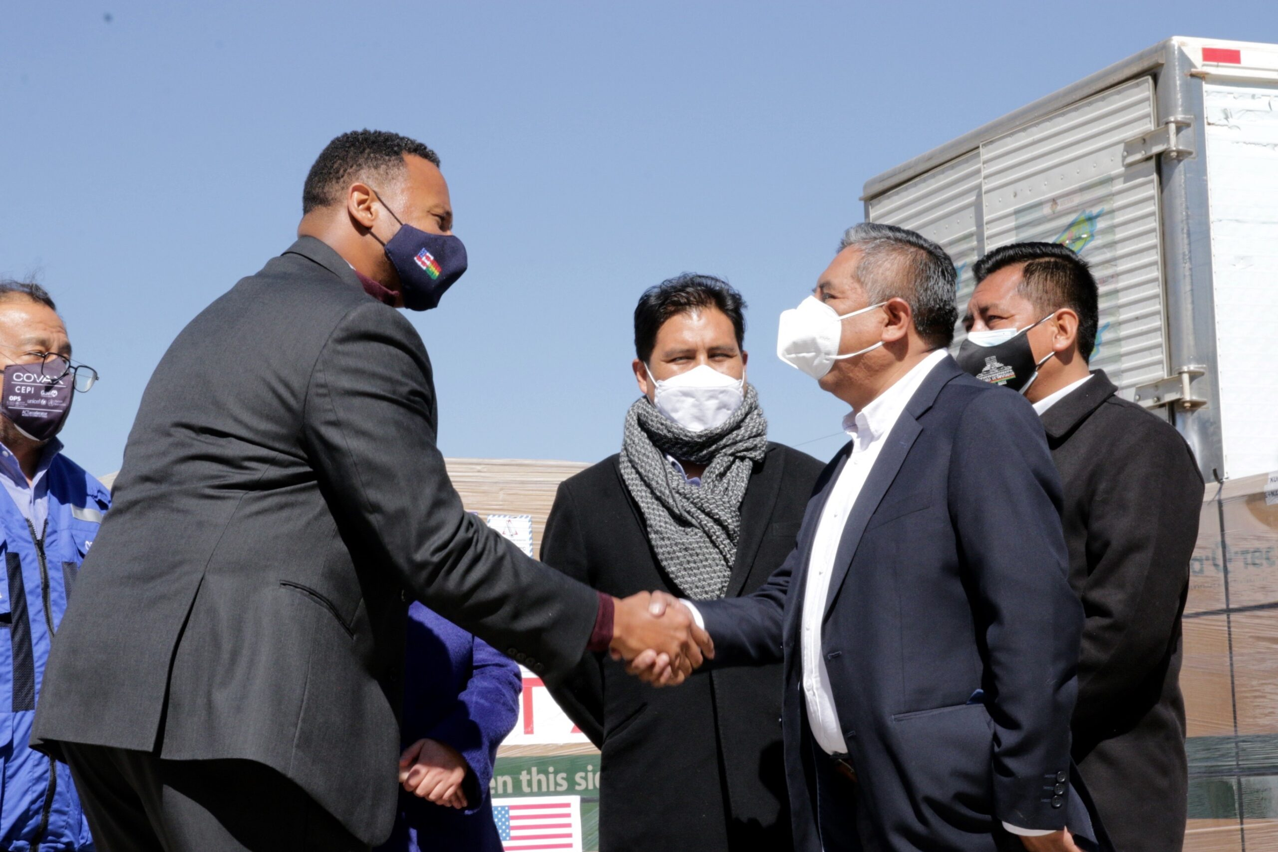 DCM Hillsman and Bolivian Foreign Minister Rogelio Mayta shakes hands at the arrival of more than 1M J&J vaccines donated by the U.S. to Bolivia.