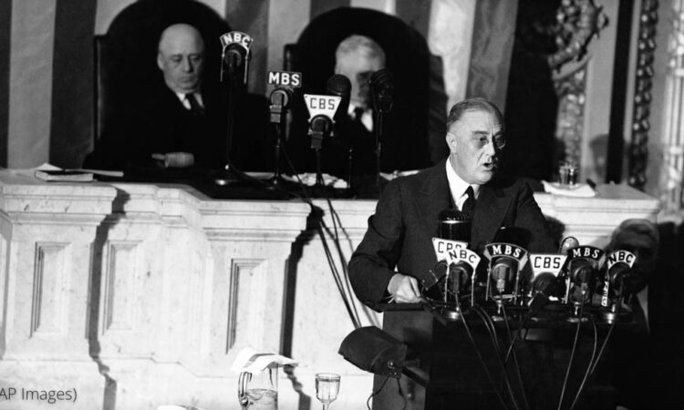 """FILE - In this Jan. 6, 1941 file photo President Franklin D. Roosevelt adresses a joint session of Congress as Speaker Sam Rayburn, left, and Vice President John N. Garner, look on. With World War II looming, Roosevelt used his 1941 address to outline the """"Four Freedoms,"""" freedom of speech, freedom of worship, freedom from want and freedom from fear. (AP Photo)"""