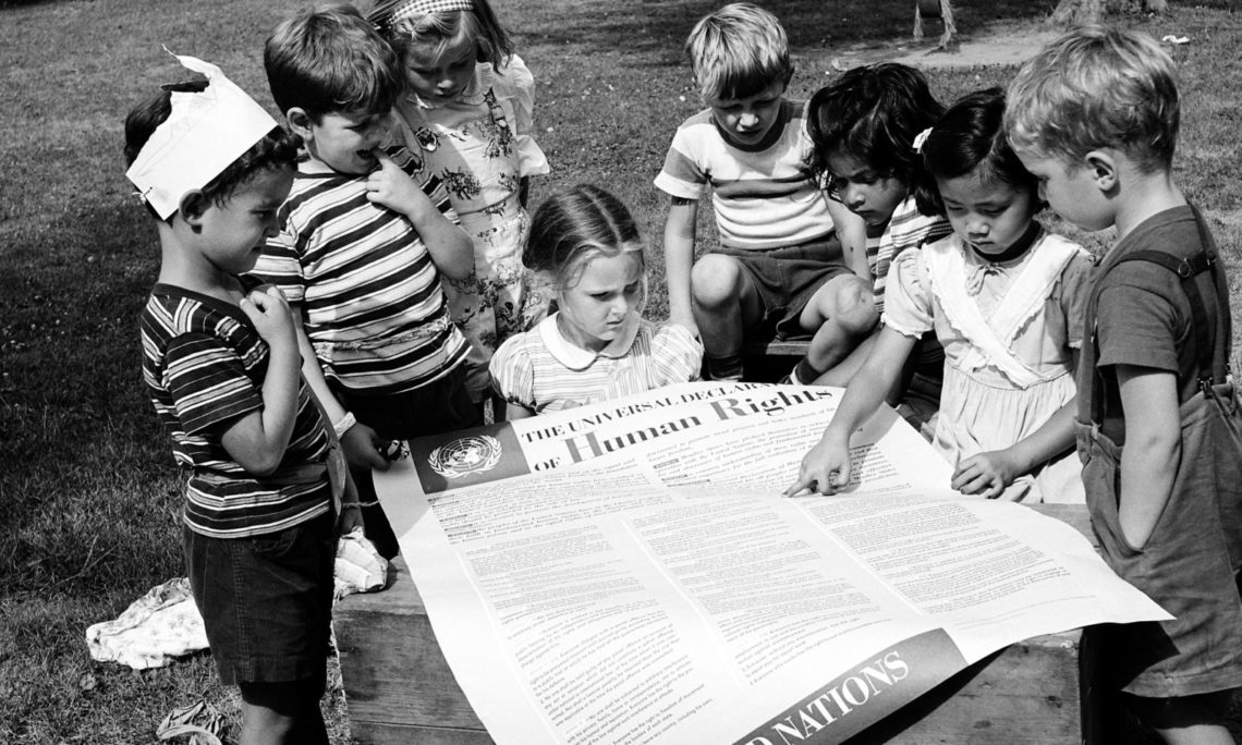 Kids looking at the Universal Declaration of Human Rights,