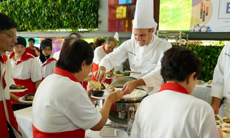 Male Chef serving food