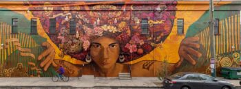 a mural of a native with flowers