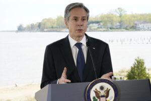 Secretary of State Antony Blinken stands at podium.