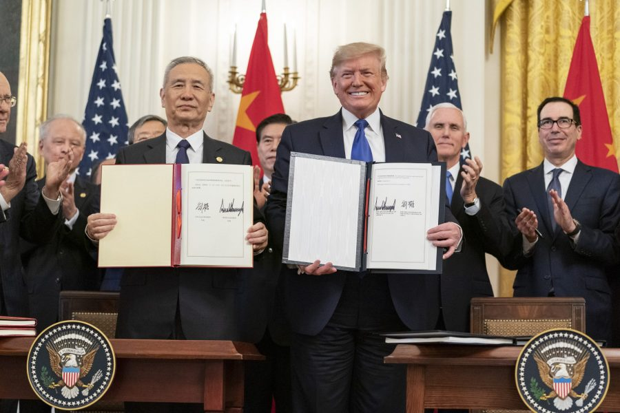 People holding up signed documents