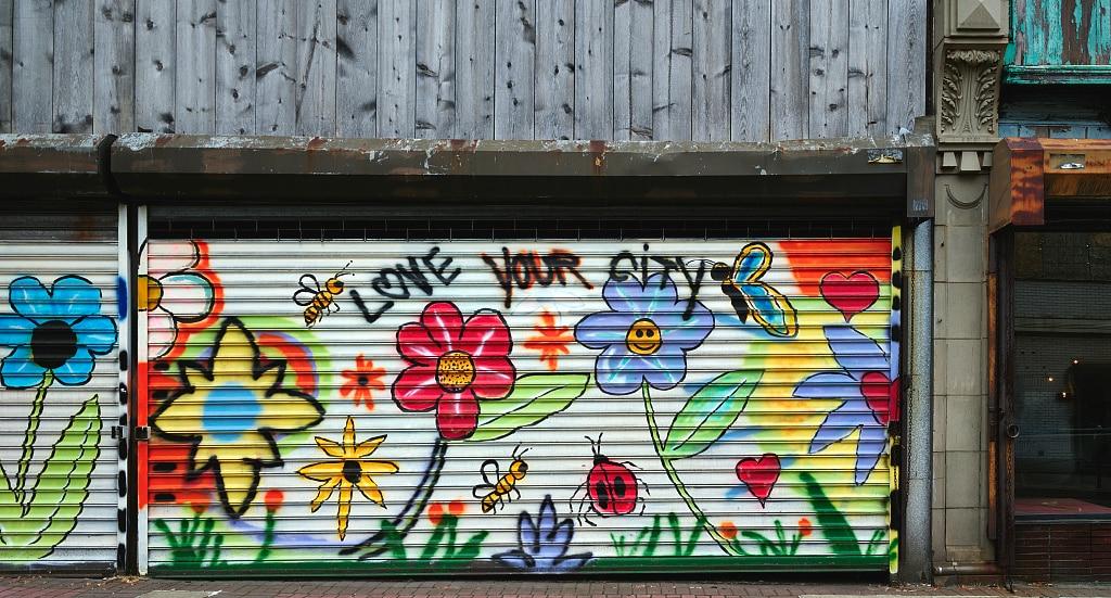 storefront wall with graffiti