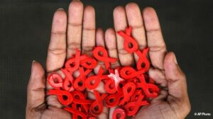 hands holding aids ribbon