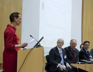 A woman speaking at a podium