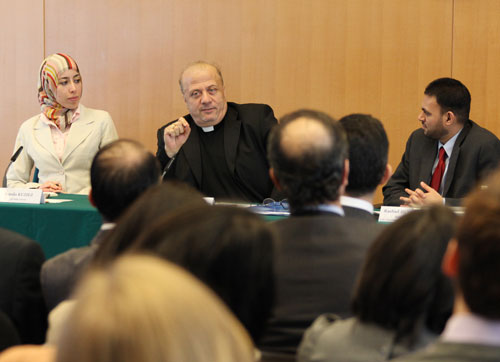 Father Nabil Haddad, Founder and CEO of the Jordanian Interfaith Coexistence Research Center responds to a question from the audience during the Interfath Harmony event at the U.S. Mission as Rashad Hussain, President Obama's Special Envoy to the OIC and Randa Kuziez, a young interfaith activist from the United States look on.