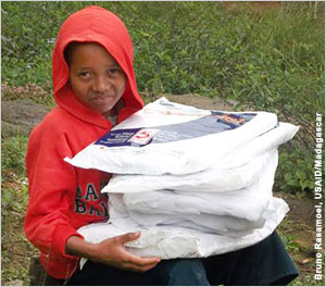 Child sits with packages