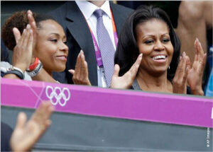 Two women applauding at an Olympic event