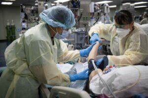 U.S. Navy Doctors, Nurses and Corpsmen Treat COVID Patients in the ICU Aboard USNS Comfort