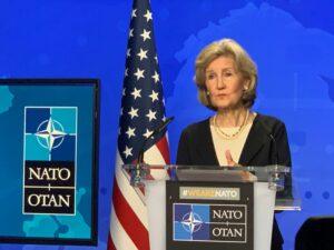 United States Ambassador to NATO Kay Bailey Hutchison behind the podium
