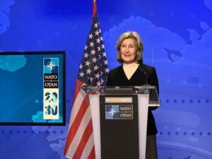 Ambassador Kay Bailey Hutchison speaking behind the podium.