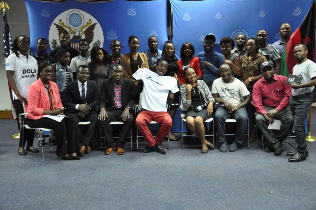 Chris and fellow young adults at a YALI Learns event in April 2019