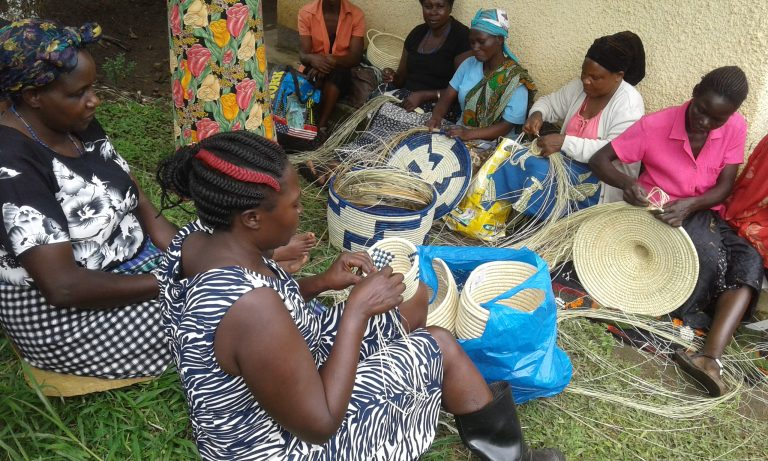 Anne Kabahuma and others making baskets