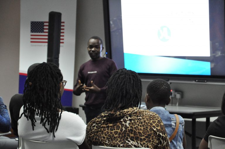 Chris delivering a speech at a 2019 YALI Learns election event