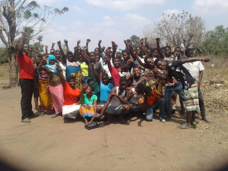 Philip and 35 young adult attendees at a leadership training in Malawi's Salima District