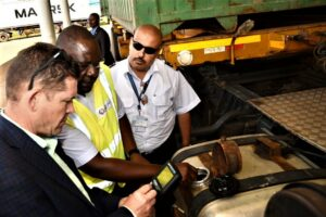 Ambassador McCarter uses a videoscope from a contraband detection kit provided by the EXBS program to detect concealed goods in hard-to-reach places.