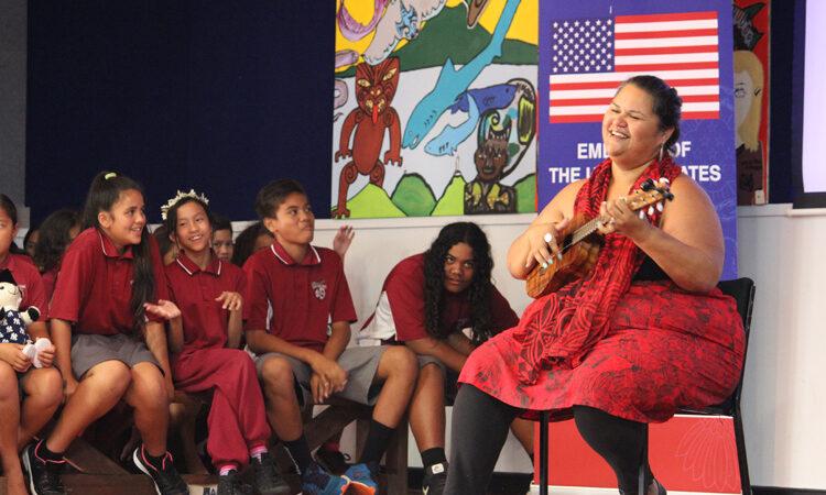 2016 Arts Envoy Paula Fuga performing Hawaiian mele for keiki at Sylvia Park School. Photo credit: U.S. Department of State.