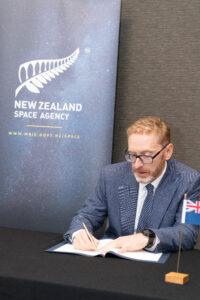 Dr. Crabtree signs on behalf of New Zealand