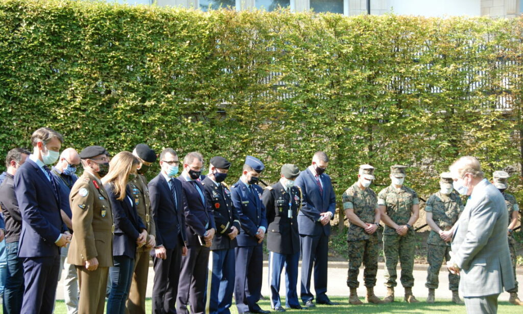 Soldiers and officials bow their head to commemorate 9/11