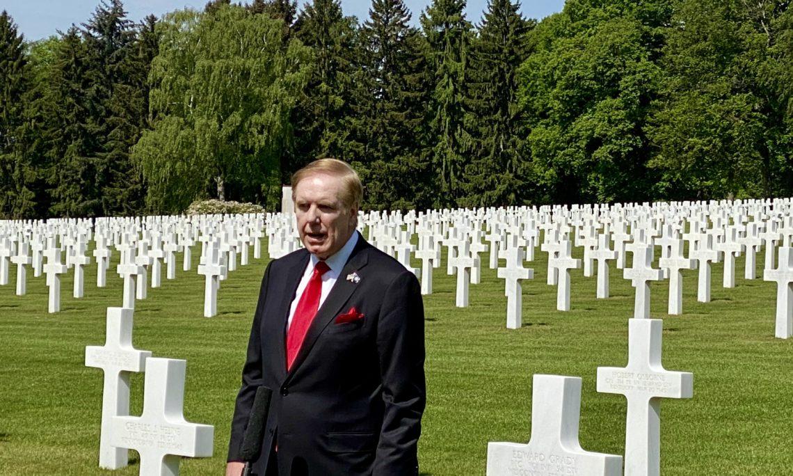 Man stands in graveyard.
