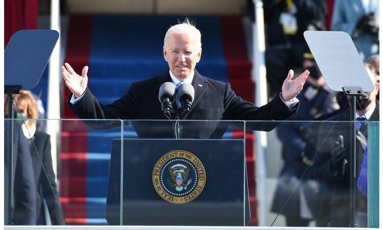 President Biden gives his inaugural address at the podium