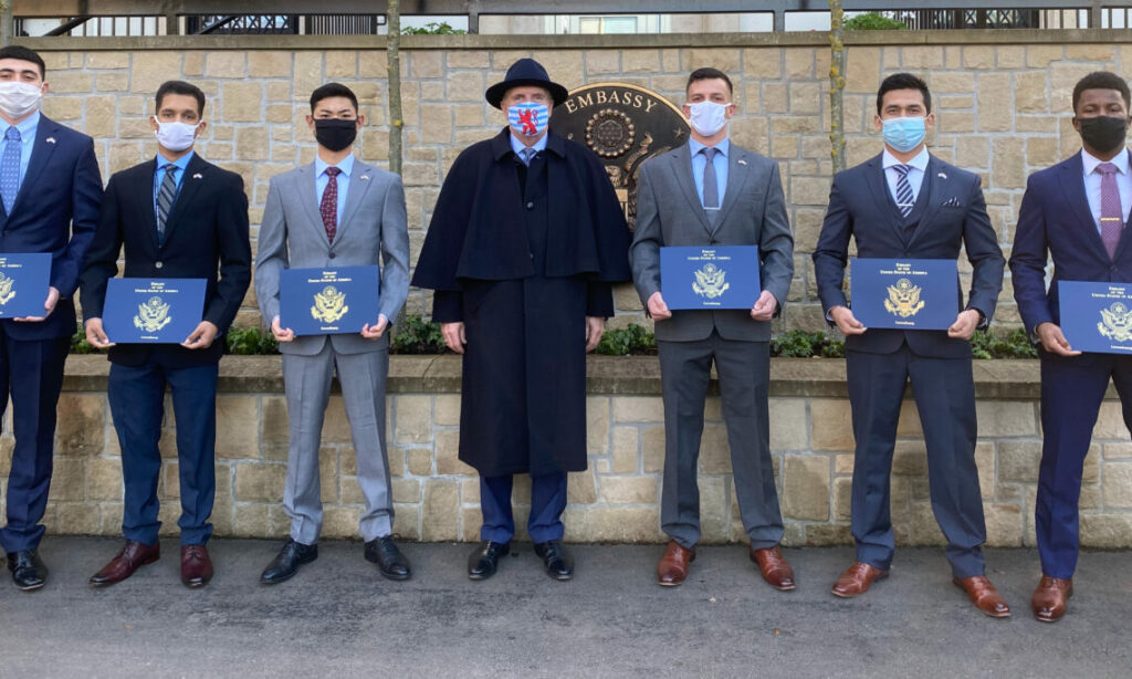 Marine Detachment poses with awards and masks on with Ambassador Randy Evans