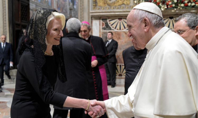 Ambassador Gingrich shakes hands with Pope Francis.