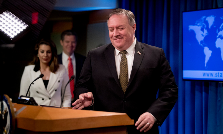 Secretary of State Mike Pompeo, accompanied by State Department spokeswoman Morgan Ortagus