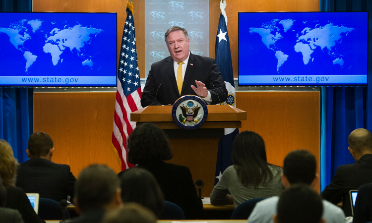 Secretary Pompeo delivering a speech at a lectern