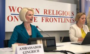 Ambassador Gingrich giving a speech next to British Holy See Ambassador